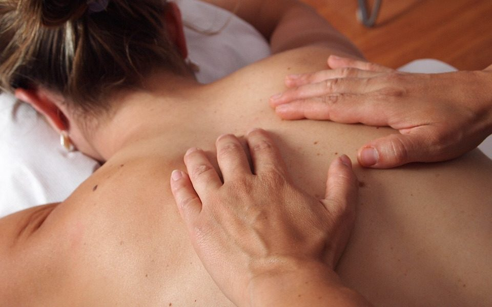 therapist performing back massage