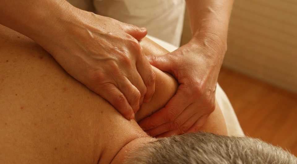 Therapist performing deep tissue massage